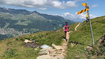 Running along mountain trails in Valais in the Swiss Alps