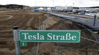 a street sign reading 'Tesla Street 1' stand in front of the construction site of the electric car Tesla Gigafactory in Gruenheide near in Berlin, Germany.