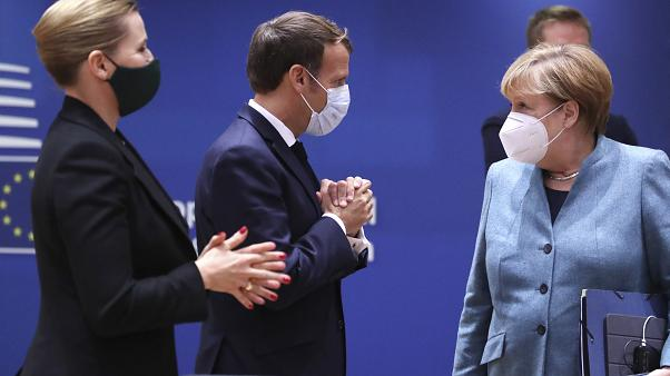 German Chancellor Angela Merkel, right, speaks with Denmark's Prime Minister Mette Frederiksen