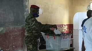 Guineans vote in high-stakes presidential election as Conde seeks third term