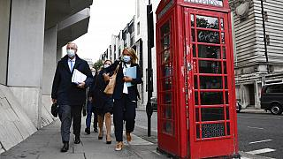 Chief EU negotiator Michel Barnier, left, makes his way to the Department for Business, Energy & Industrial Strategy, in London, Wednesday, Sept. 23, 2020.