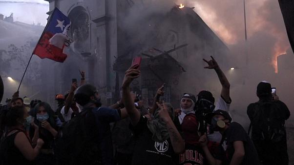 people taking selfies in the smoke caused by collapsed church spire