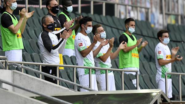FILE-In this May 31, 2020 file photo Moenchengladbach alternate players wearing face masks applaud during the German Bundesliga match against Union Berlin.