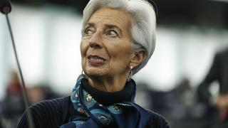 In this Tuesday Feb. 11, 2020 file photo, Christine Lagarde president of the ECB looks up prior to deliver her speech before the European Parliament's economic and monetary af