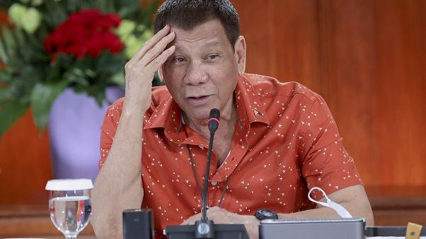 In this photo provided by the Malacanang Presidential Photographers Division, Philippine President Rodrigo Duterte attends a meeting at the Malacanang presidential palace.