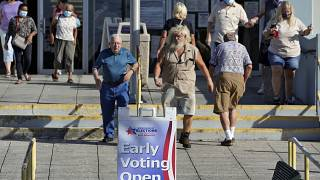 Voters leave the Polk County Gov. Center after casting their ballots Monday, Oct. 19, 2020, in Lakeland, Fla. Chris O'Meara/Copyright 2020 The Associated Press.