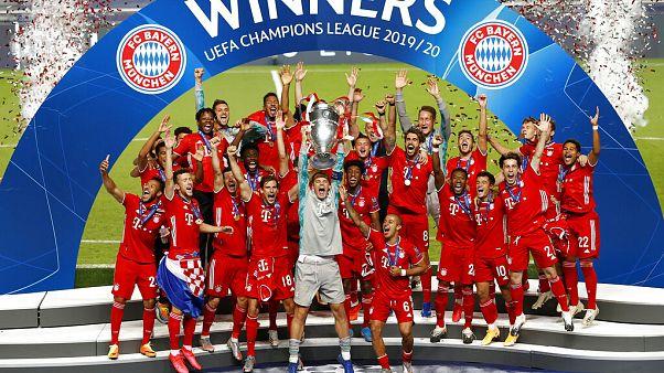 Bayern's goalkeeper Manuel Neuer lifts the trophy after Munich won the Champions League final soccer match.
