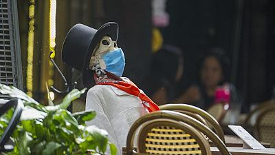 A Calaca is used to keep social distancing measures in Mexico City during Day of the Dead celebrations