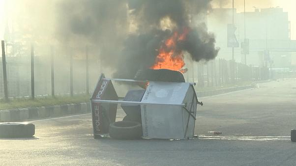 Overturned toll booth on fire