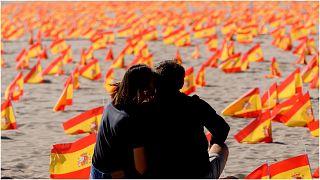 أعلام إسبانية تكريما لضحايا كوفيد 19