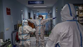 A medical team member is disinfected before leaving the COVID-19 ward at the Severo Ochoa hospital in Leganes, outskirts of Madrid, Spain.