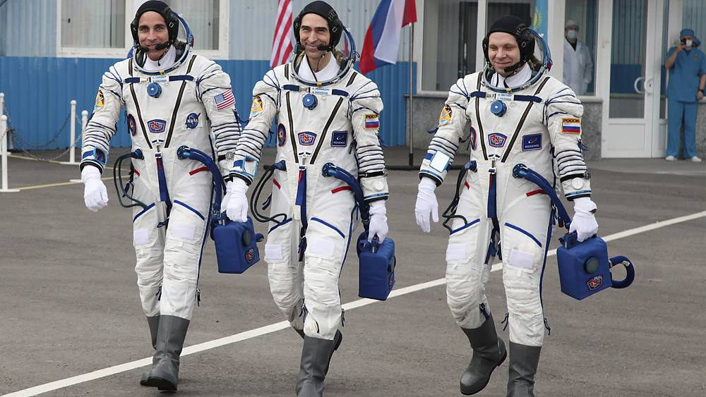 Astronaut and cosmonauts return to Earth after mission launched during pandemic