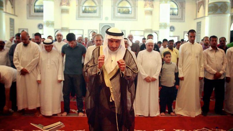 Sheikh Dr. Fares Ali Mustafa prays in a mosque