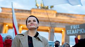 Belarusian opposition leader Svetlana Tikhanovskaya is welcomed by supporters, during a rally, by the Brandenburg Gate in Berlin, Monday, Oct. 5, 2020.