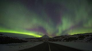 Northern Lights, or aurora borealis, appear in the sky over Bifrost, Western Iceland.