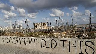 Political graffiti is visible in front of the scene of the August 4 explosion that hit the seaport of Beirut, Lebanon.