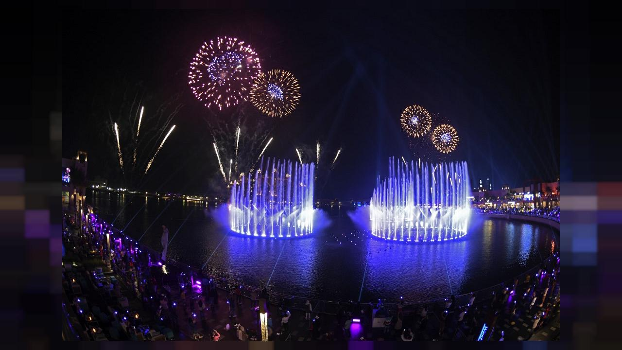 Fireworks explode over The Palm Fountain, world's largest fountain opening ceremony which breaks the Guinness World Record at the Pointe in Dubai