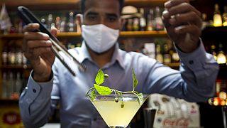 """bartender Dagoberto Jesus Morejon prepares a """"Martini de Oro,"""" or Golden Martini, a cocktail using a plant endemic to Cuba called the """"Orozus de la Tierra."""""""