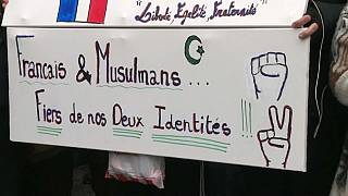 """Close-up of a sign saying """"French and Muslim, proud of our two identities"""", during a march against Islamophobia in France"""