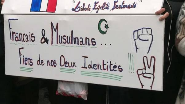 "Close-up of a sign saying ""French and Muslim, proud of our two identities"", during a march against Islamophobia in France"