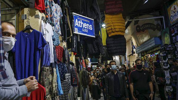 University students wearing face masks to curb the coronavirus protest as they walk in Monastiraki flea market in Athens
