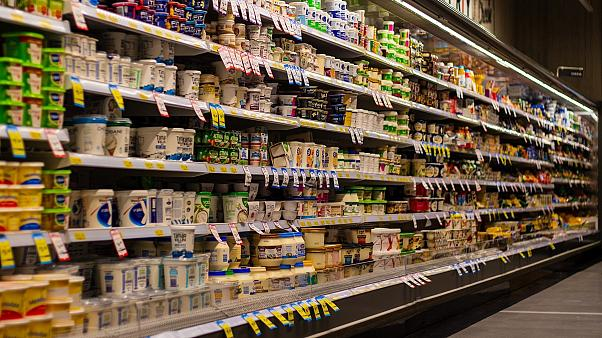 Products line the shelves of a supermarket.