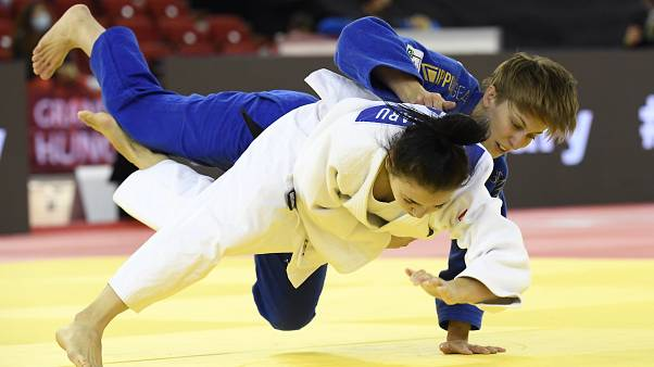 Reka Pupp, top, of Hungary and Cristina Blanaru of Moldova fight in the women's -52 kg category of the Judo Grand Slam Budapest