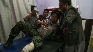 A wounded man receives treatment in a hospital following a suicide bomber blew himself up in an education centre, in Kabul on October 24, 2020.
