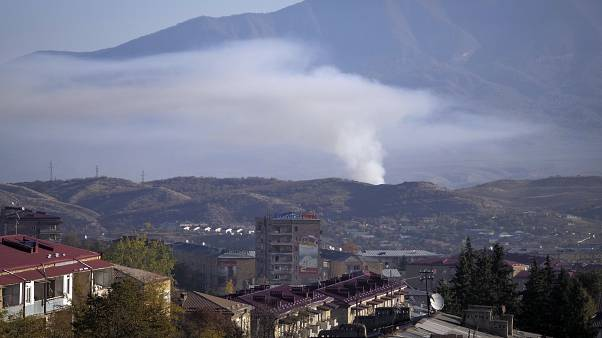 Smoke rises after shelling by Azerbaijan's artillery during a military conflict in Stepanakert, the separatist region of Nagorno-Karabakh, Saturday, Oct. 24, 2020.