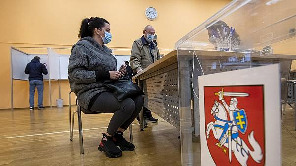 Lithuanians wait for ballots at a polling station during early voting in the second round of elections in Vilnius, Lithuania, on Thursday, October 22, 2020.