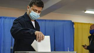 Ukrainian President Volodymyr Zelenskiy casts his ballots at a polling station during a local elections in Kyiv, Ukraine.
