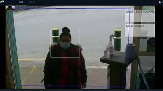 Customers' faces are scanned for masks as they enter the store