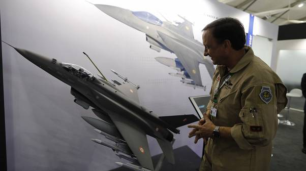 In this Feb. 5, 2020, file photo, Lockheed Martin's Robert Balserak, Lead Executive, Air Superiority Programs, explains the capabilities of the F-21 at the DefExpo in Lucknow