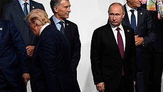 بوتين بجانب ترامب