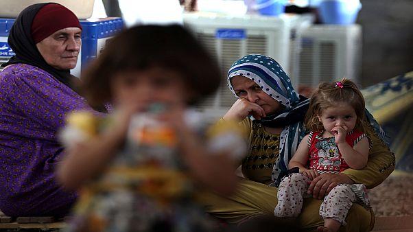 صورة لامرأتين وطفلتين في إحدى قرى كردستان العراق