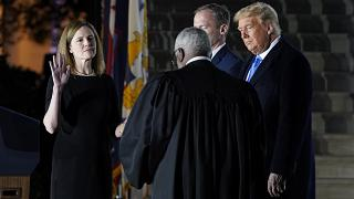 President Donald Trump watches as the Constitutional Oath is administered to Amy Coney Barrett at the White House in Washington, Ocober 26, 2020.