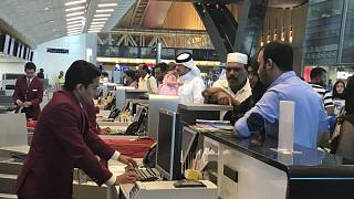 In this Monday, June 12, 2017 photo, Qatari and other nationals queue at the check in counters of the Hamad International Airport in Doha, Qatar
