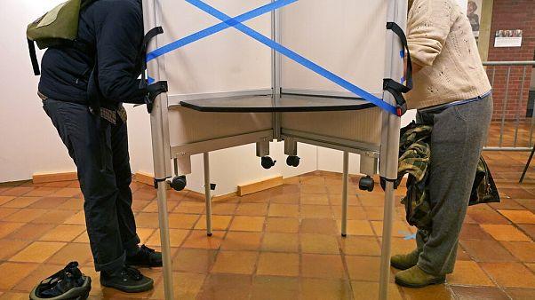 Des électeurs aux urnes à l'hôtel de ville de Boston lors du vote anticipé, le 26 octobre 2020