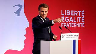 French President Emmanuel Macron delivers a speech to present his strategy to fight separatism, Friday Oct. 2, 2020 in Les Mureaux, outside Paris.