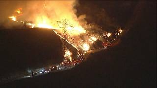 Firefighters battle Silverado Fire ripping through southern California
