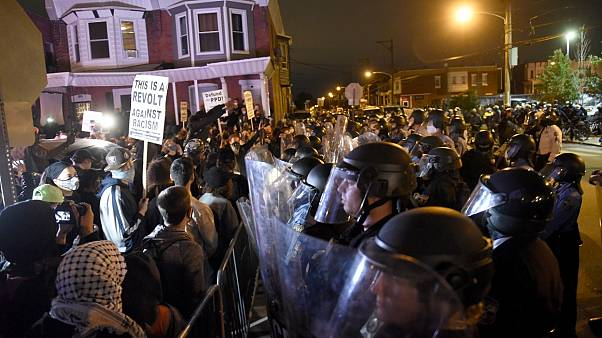 Protesters face off with police during a demonstration Tuesday, Oct. 27, 2020, in Philadelphia. Hundreds marched over the police shooting of Walter Wallace, 27.