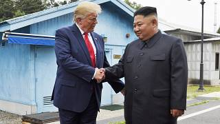 In this June 30, 2019, file photo, President Donald Trump shakes hands with North Korean leader Kim Jong Un in the Demilitarized Zone, South Korea.