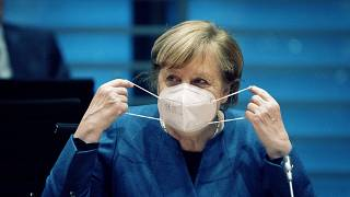 German Chancellor Angela Merkel wears a face mask as she arrives for the weekly cabinet meeting at the Chancellery in Berlin, Germany, Wednesday, Oct. 28, 2020.