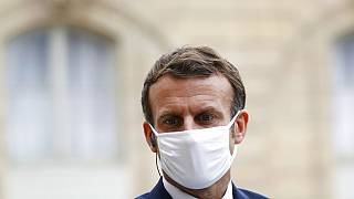 France's President Emmanuel Macron wears a mask during a speech of Estonia's Prime Minister Juri Ratas, at the Elysee Palace, in Paris