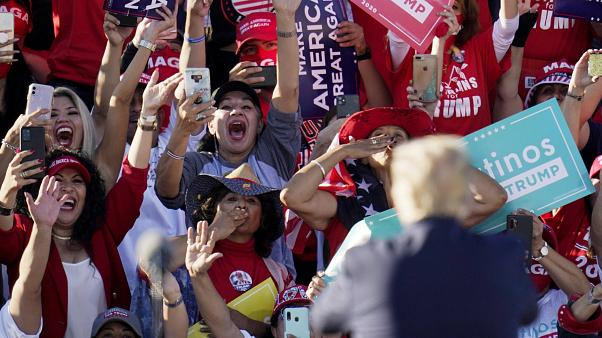 President Donald Trump acknowledges the cheering crowd behind him at a campaign rally at Phoenix Goodyear Airport Wednesday, Oct. 28, 2020, in Goodyear, Arizona.