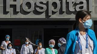 Medical staff and nurses wearing face masks gather during a protest demanding an improvement in wages and labour conditions at La Paz hospital in Madrid, Spain