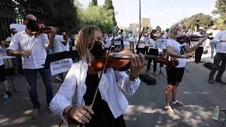 The Israel Philharmonic Orchestra performs outside Knesset in protest of Covid-19 lockdown measures