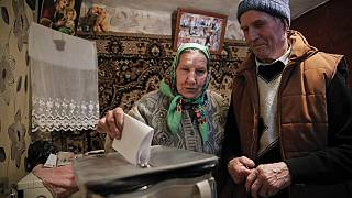 A woman casts her vote in a mobile ballot box in the village of Stolniceni, Moldova, Sunday, Feb. 24, 2019.