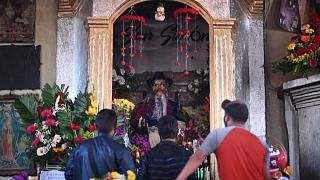 With alcohol and music, Guatemalans make offerings to folk saint San Simon