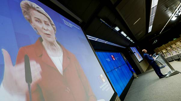 European Council President Charles Michel, right, and European Commission President Ursula von der Leyen, left, via video link